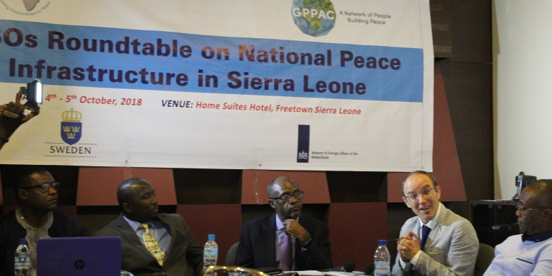 A picture taken during the discussion at the Roundtable on National Peace Infrastructures in Sierra Leone, from left to right: Mr. Charles Lahai, director of PAACET, Hon. Solomon Jamiru, the Deputy Minister of Information and Communication, Dr. Sam Doe, Country Director UNDP, and Mr. Pascal Richard, GPPAC Managing Adviser Policy and Advocacy.